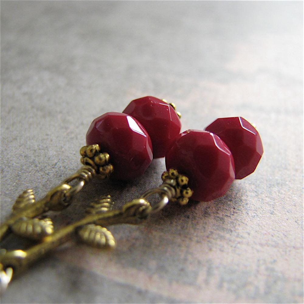 Elegant Foliage earrings - berry colored faceted glass with antiqued golden leaves